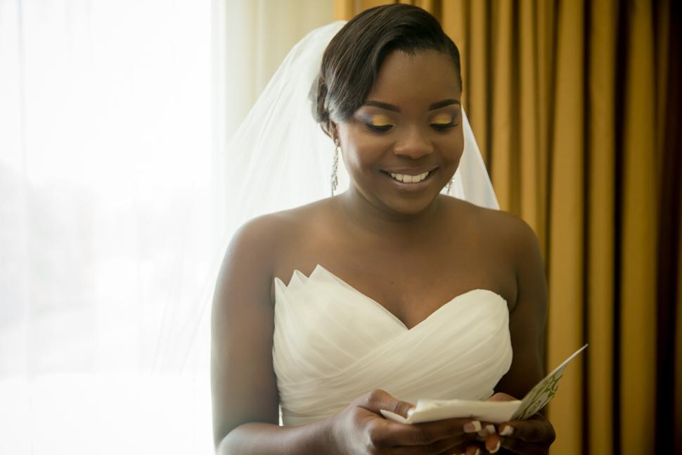 Bride enjoying grooms note wedding