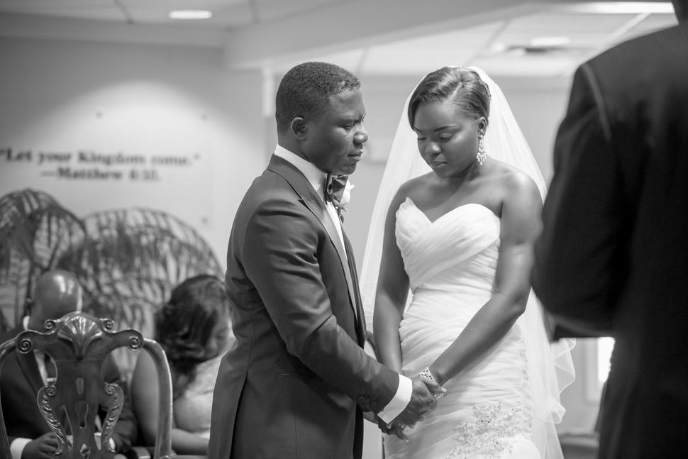Bride and Groom share a prayer Wedding