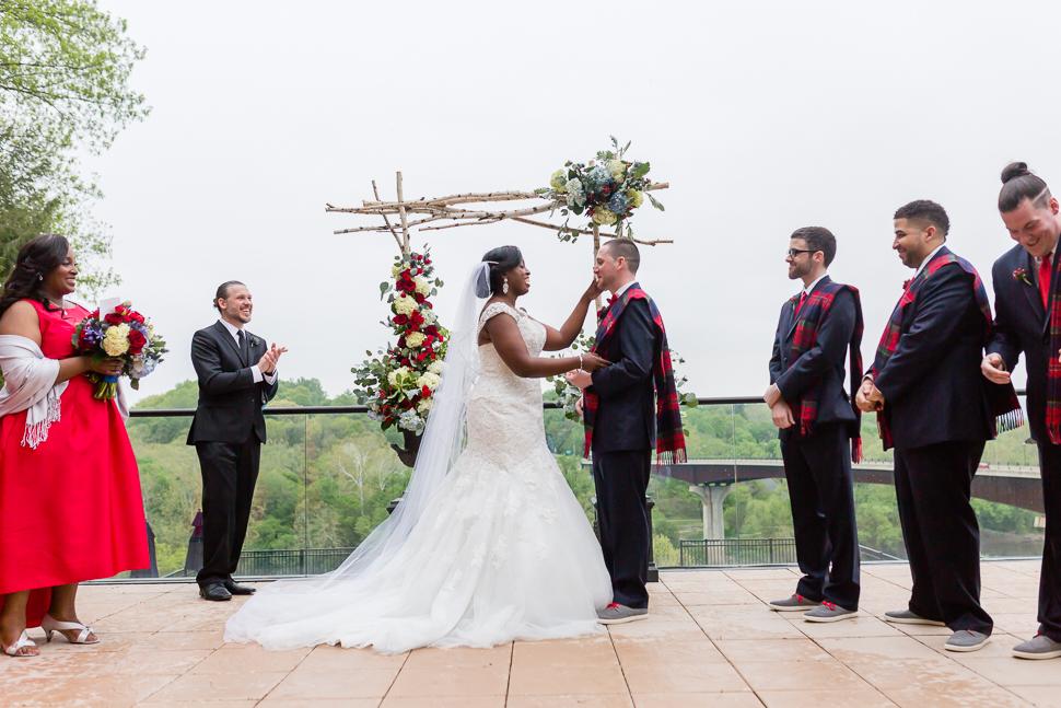 Bride wipes away grooms tears